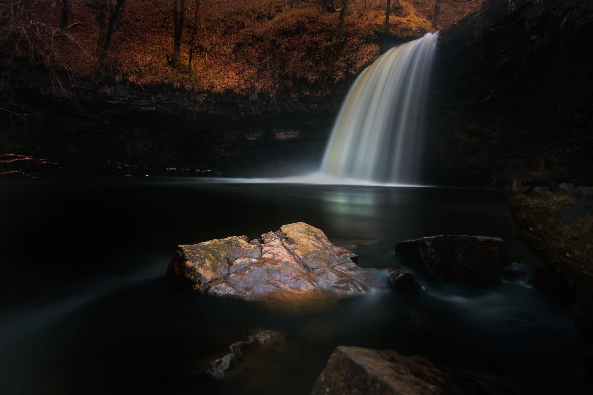 A dark and moody long exposure of the waterfall known as Lady Falls or Sgwd Gwladus on the river Afon Pyrddin near Pontneddfechan, South Wales, UK