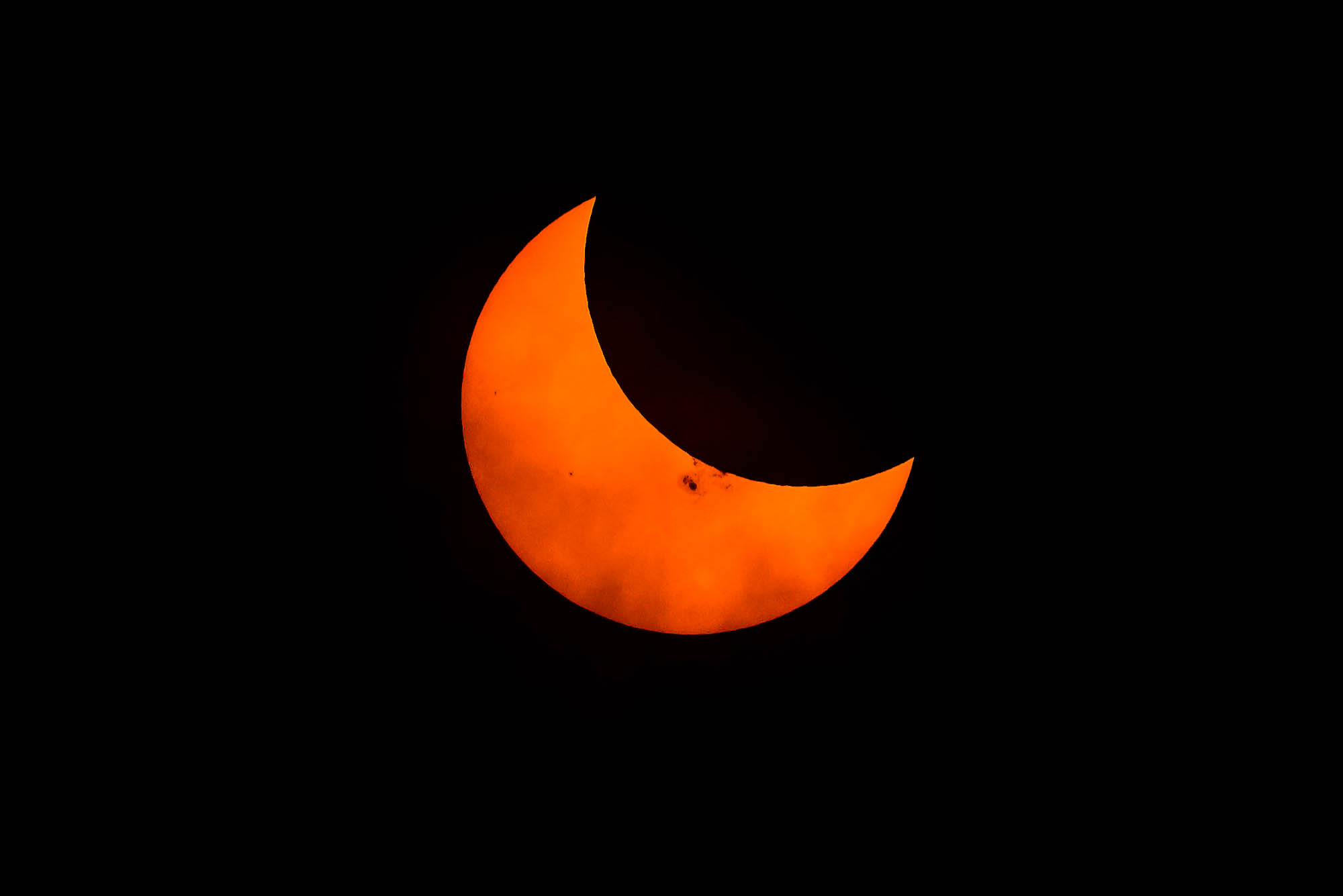 October 23, 2014 partial solar eclipse from Vancouver, Canada. Image shows large sunspot cluster.