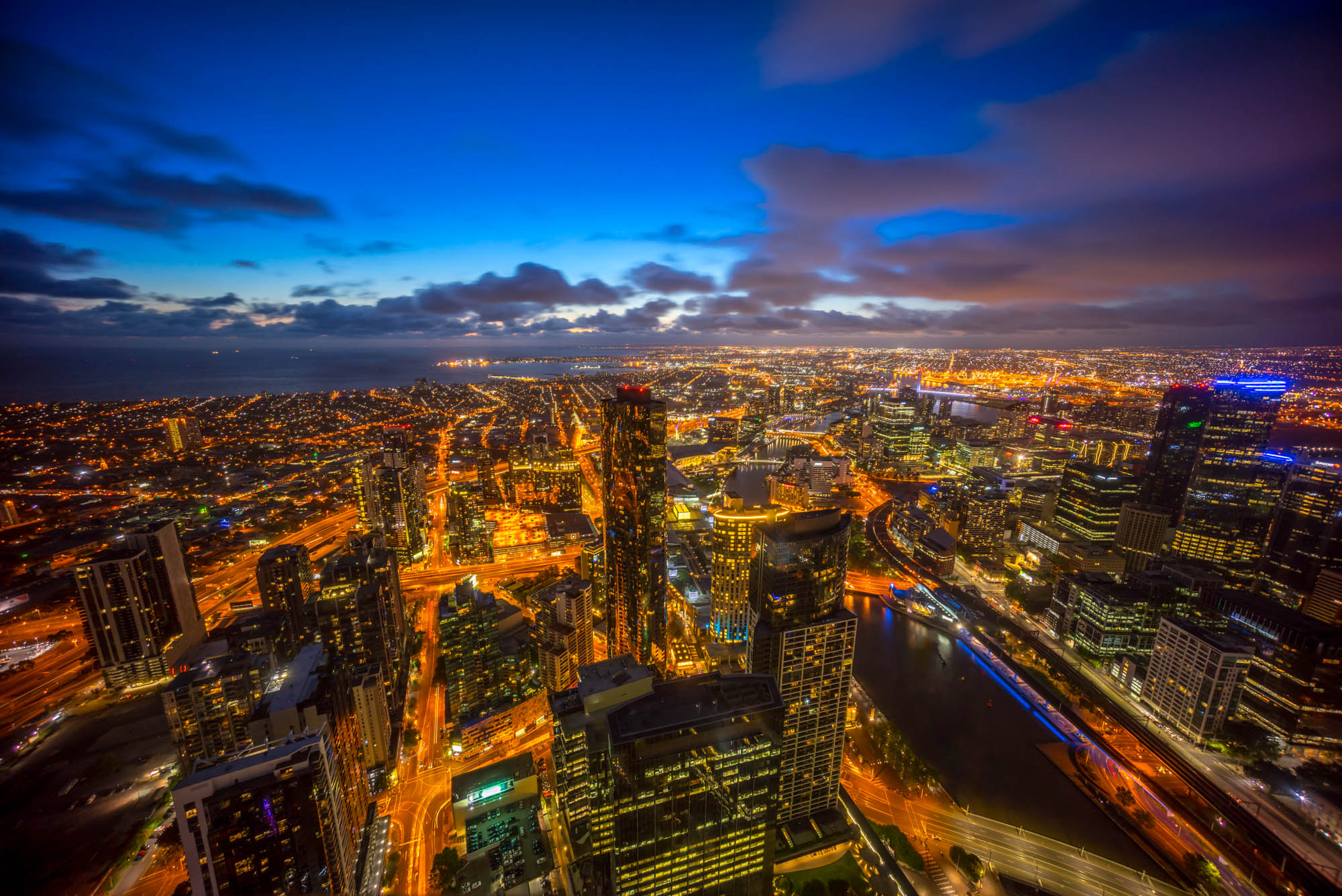 Aerial view of a dramatic sunset over Melbourne city skyline