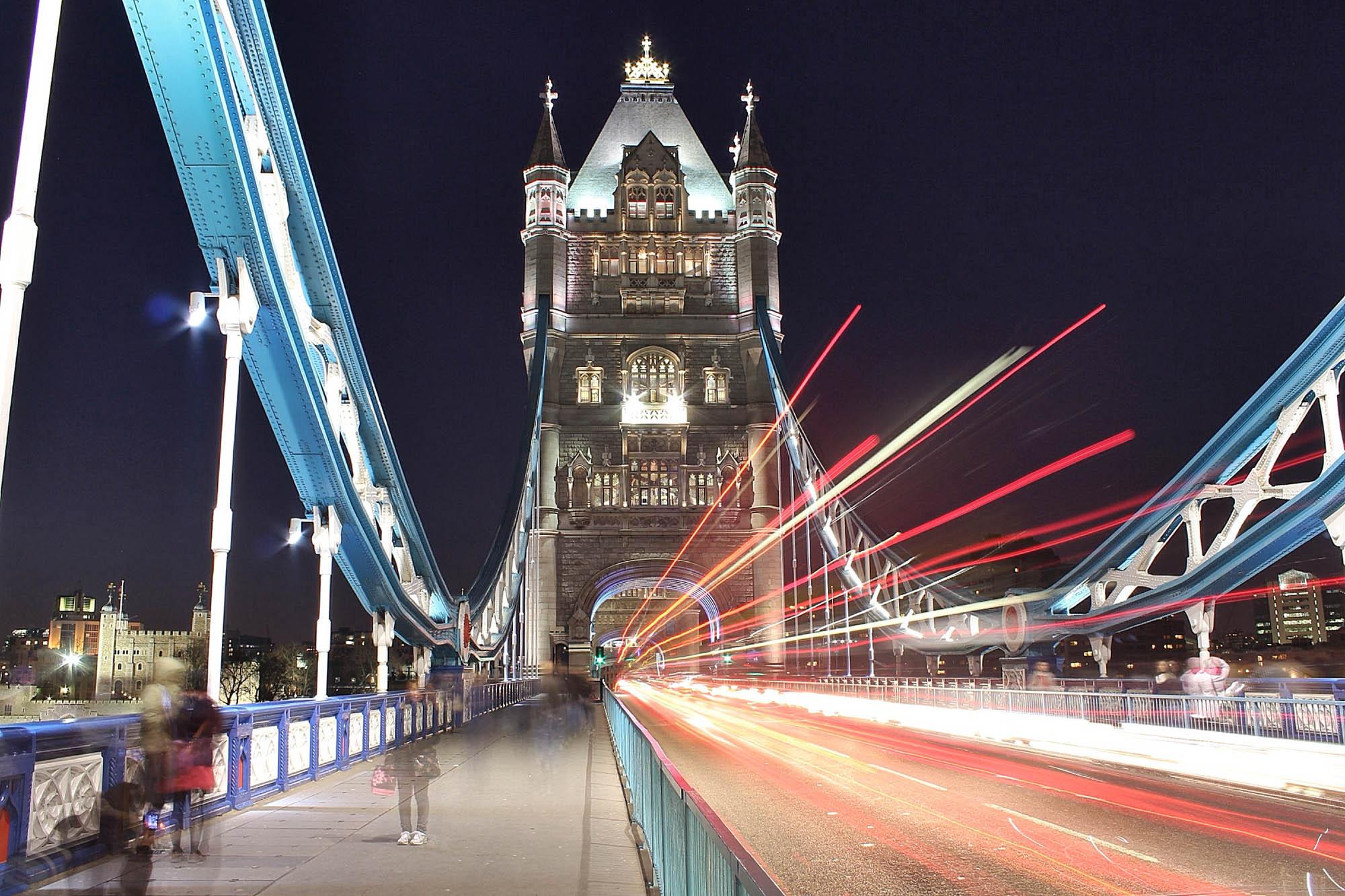 Night shot of traffic travelling over Tower Bridge, London