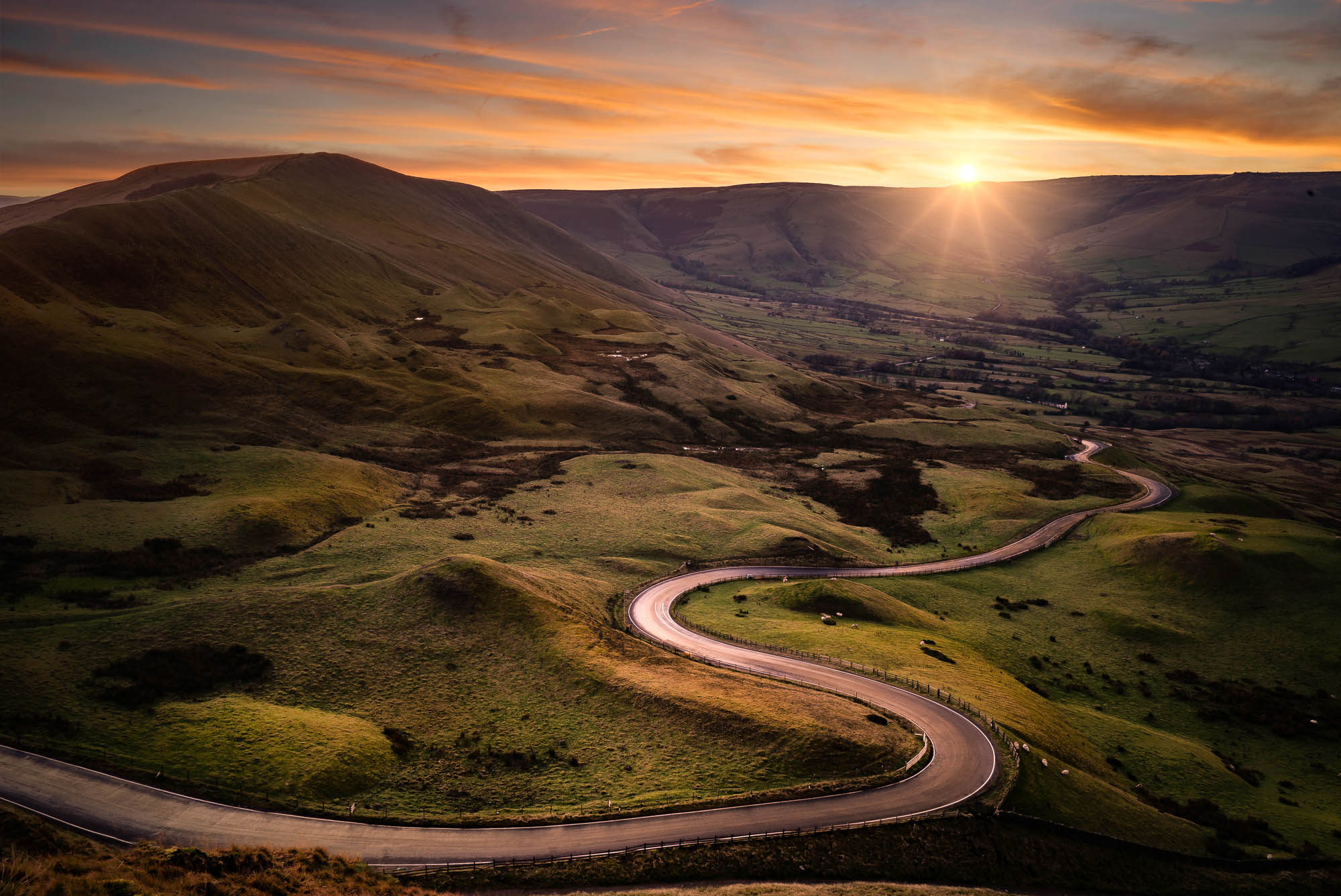 The road from Edale snakes its way up to Mam Tor in the glorious Derbyshire Peak District.
