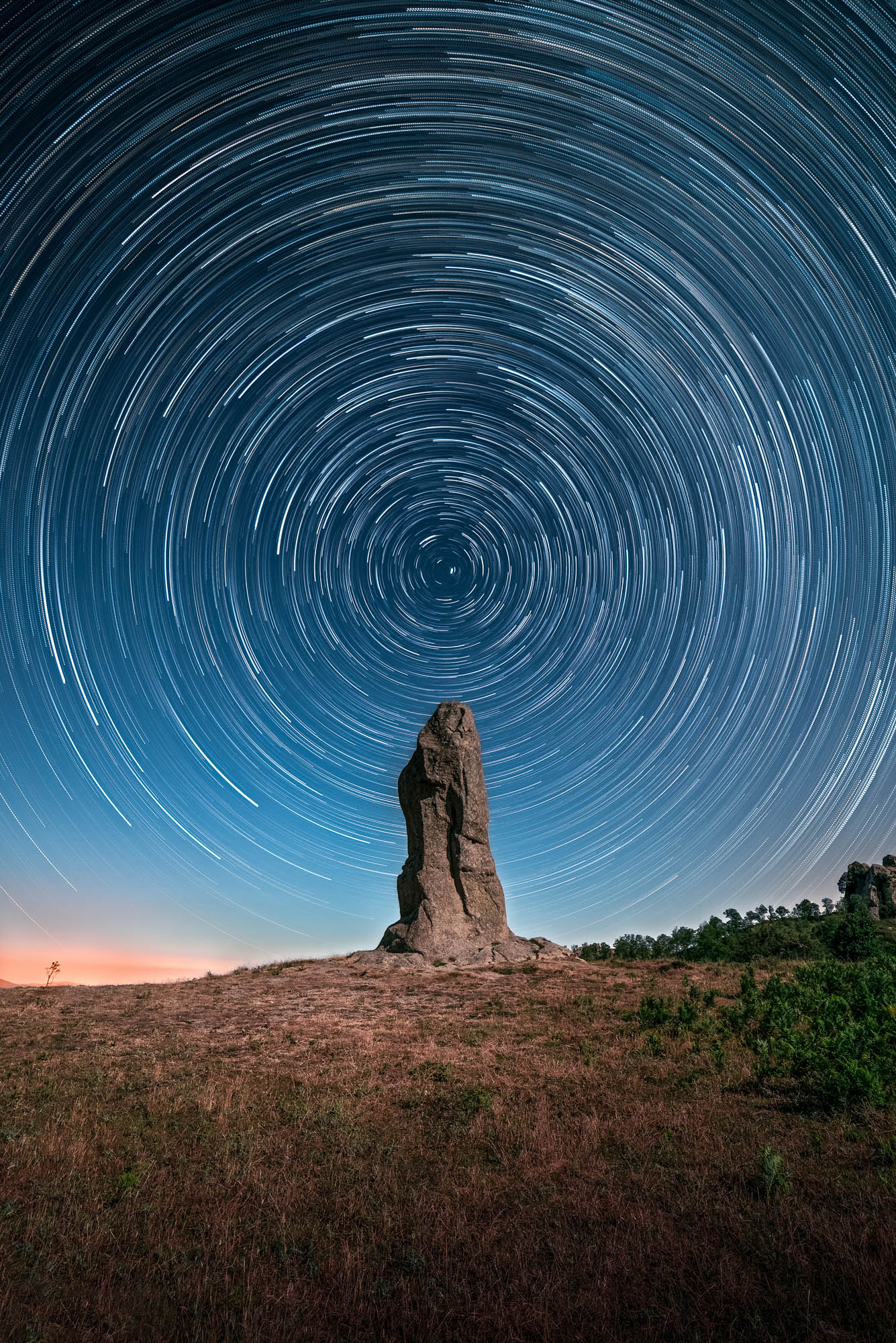 Startrail of 120 shots taken at the Argimusco megaliths, in the territory of Santa Domenica Vittoria, in Sicily.