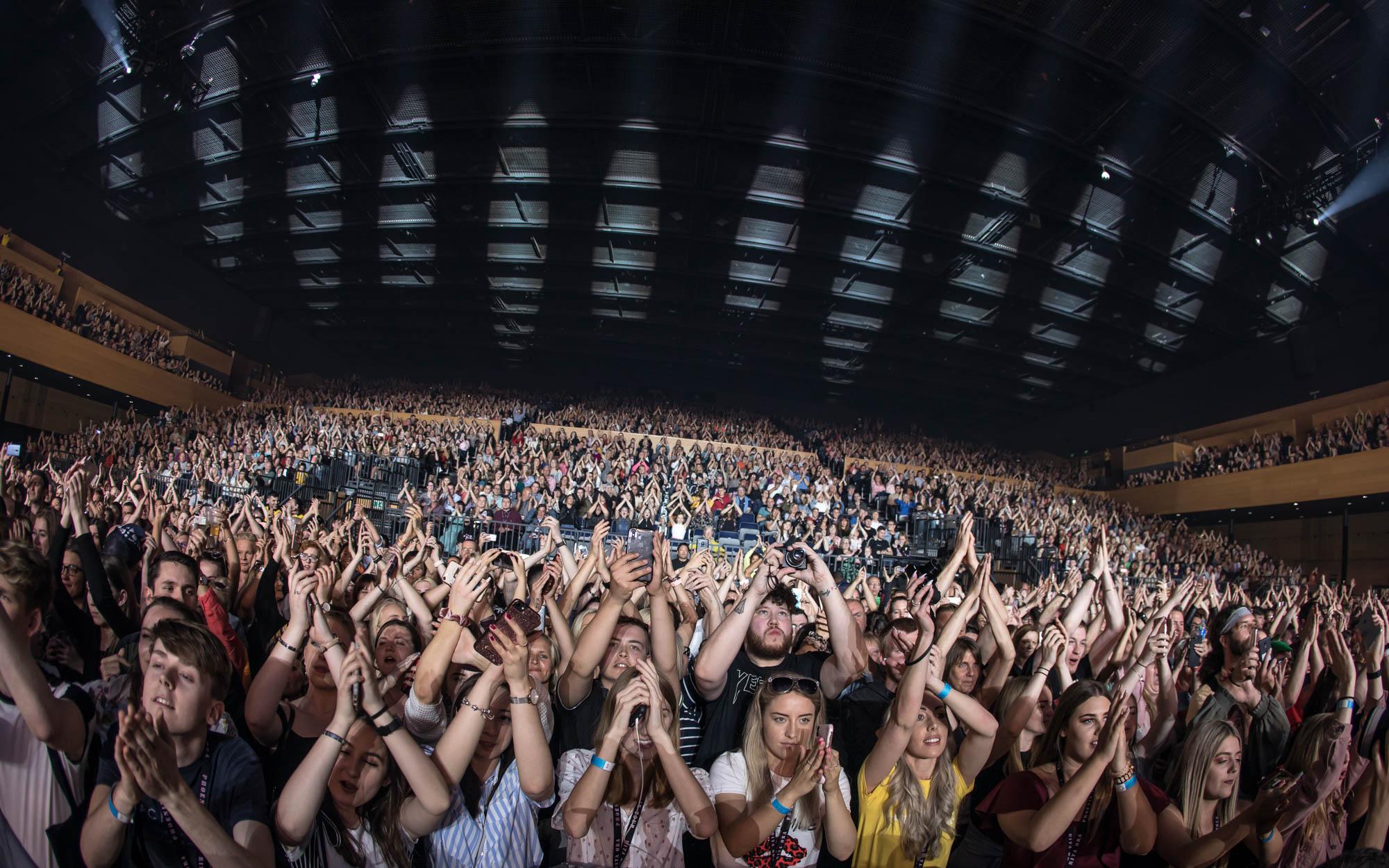 The crowd enjoying Rita Ora performing at the Bournemouth International Centre.
