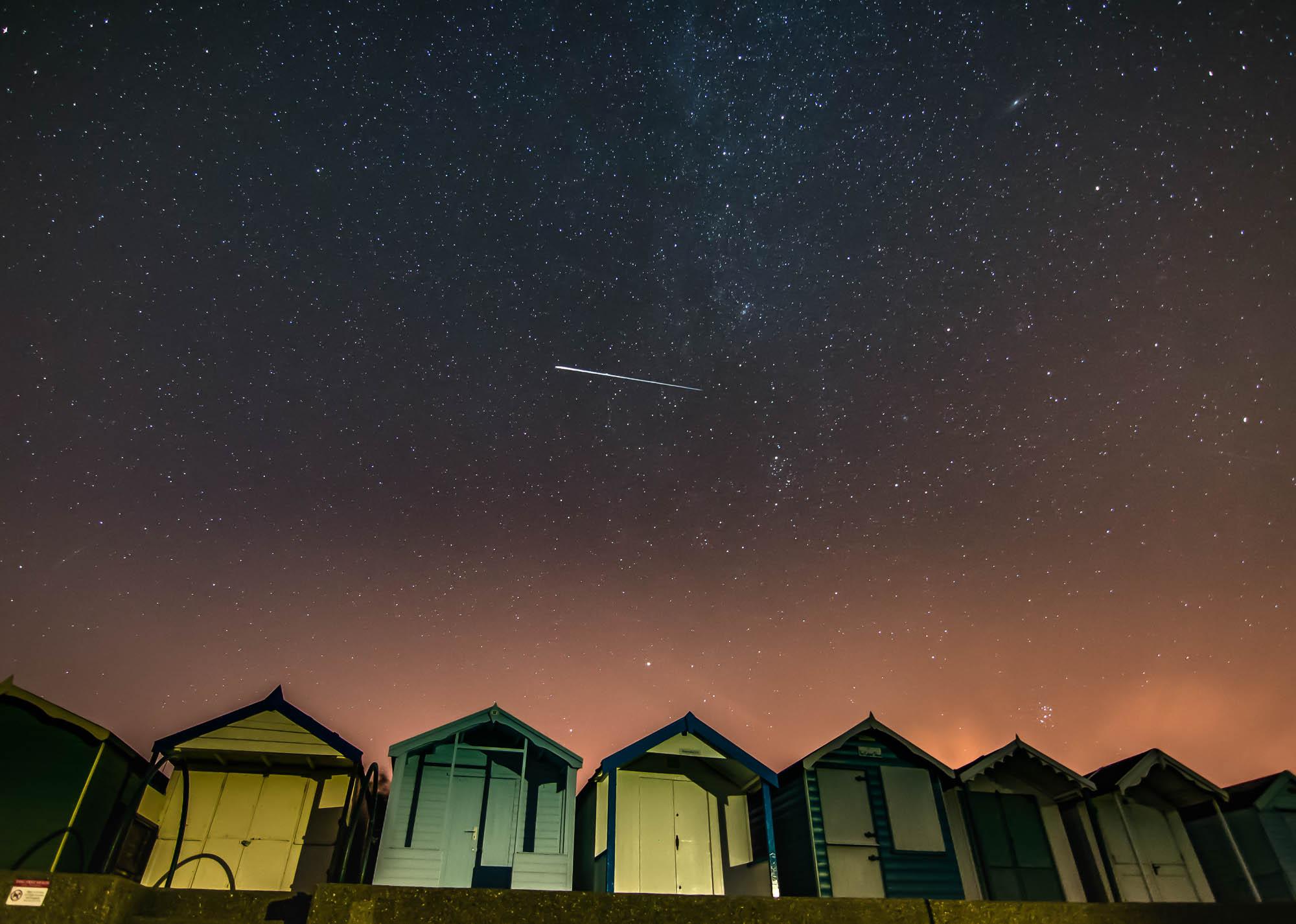 A Perseid meteor streaks across a star filled sky above Brightlingsea beach on an August night.