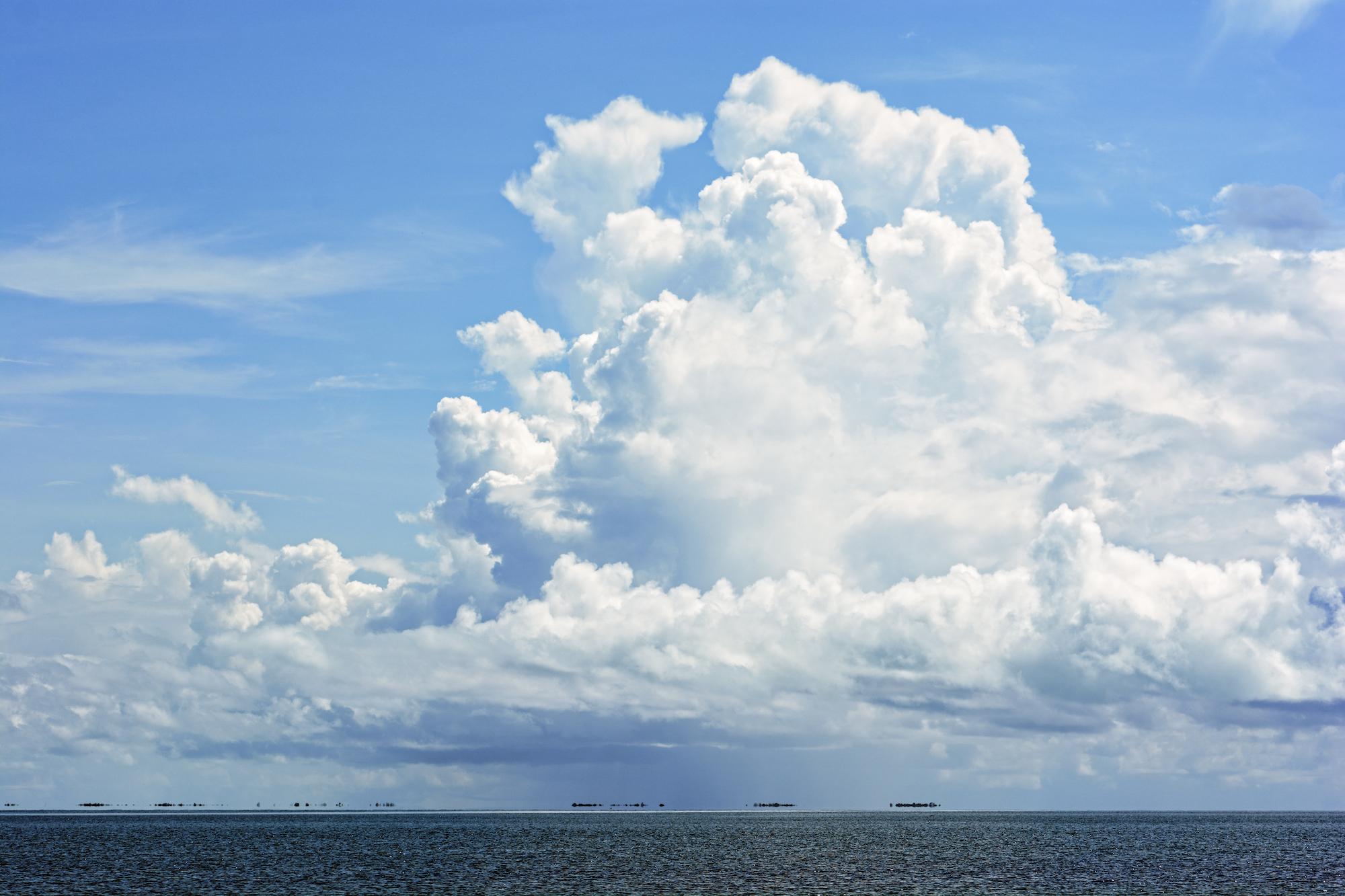 Big white clouds over the sea