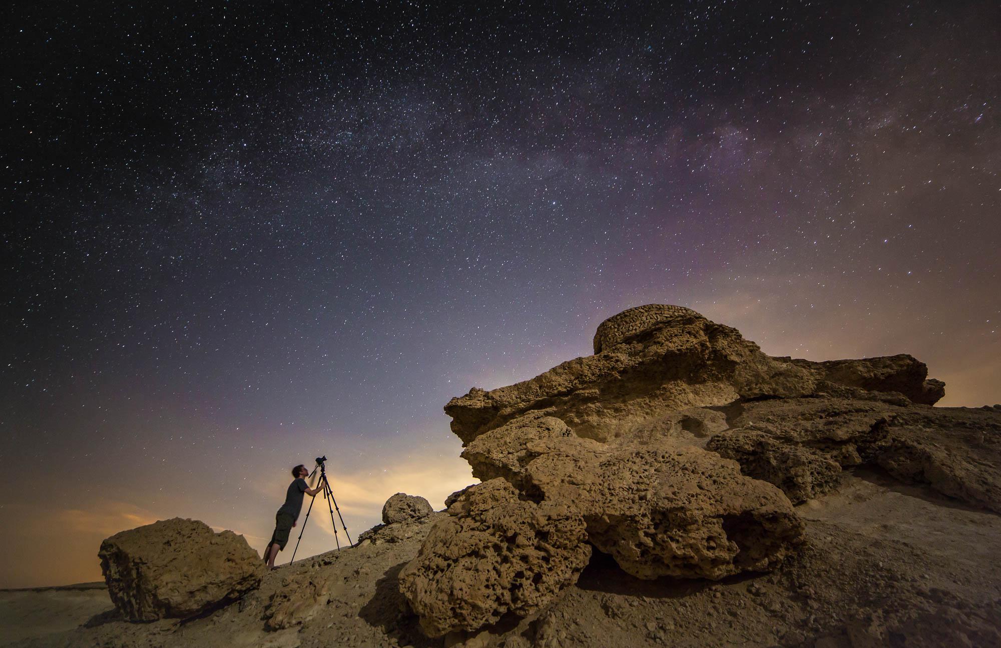 Photographer capturing the night sky