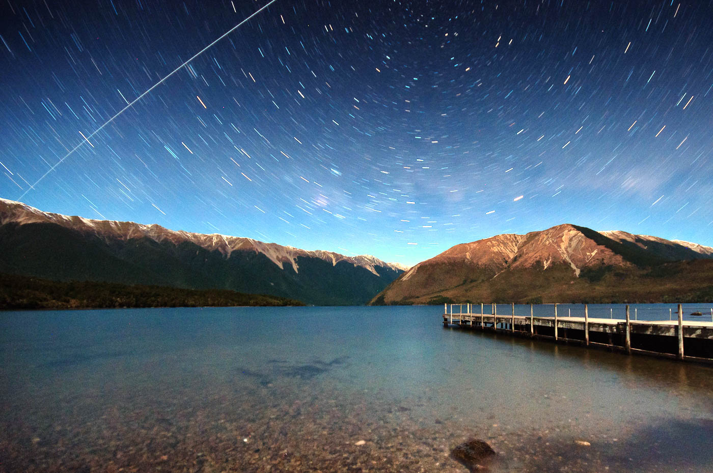 The International Space Station in a star trail over Lake Rotoiti, New Zealand.