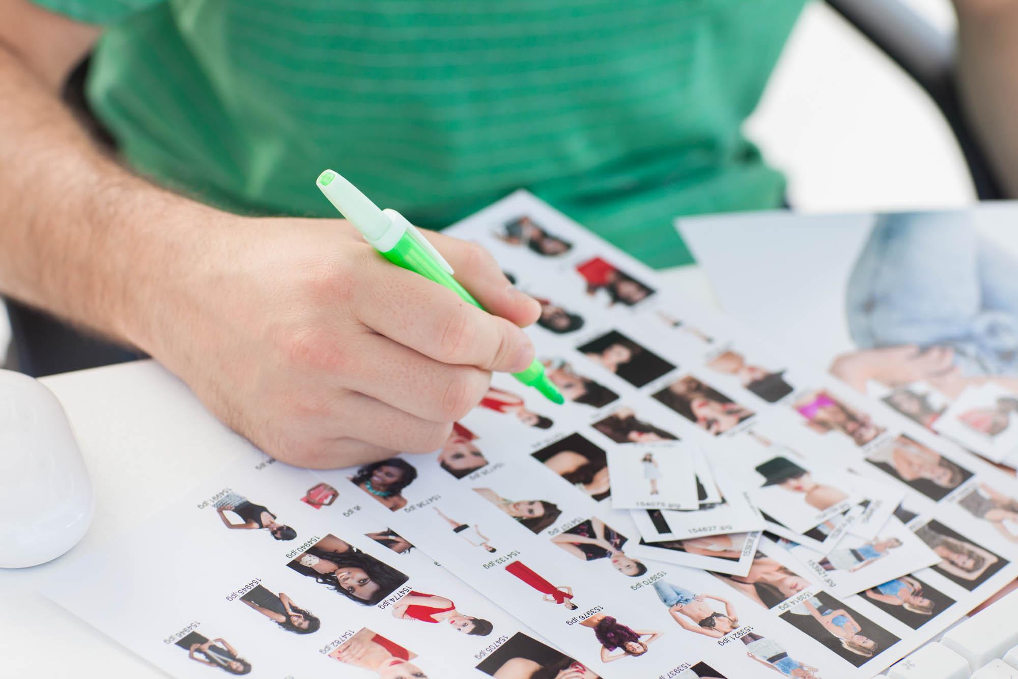 Photo editor looking through contact sheets