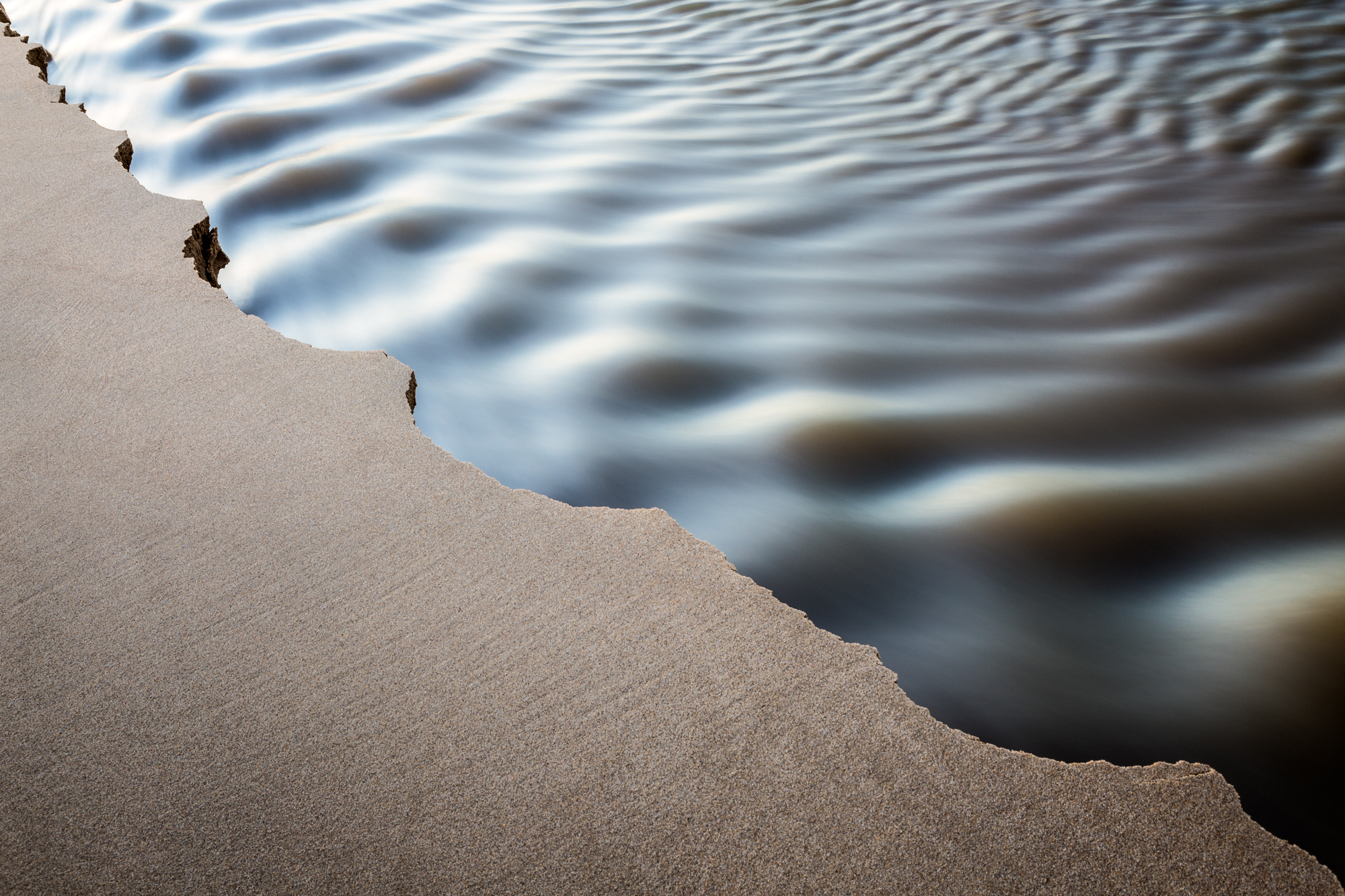 Sand and water abstract.