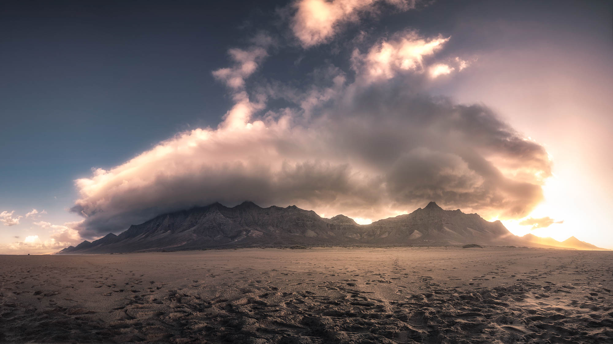 Panoramic to the mountains on cofete with a weird clouds
