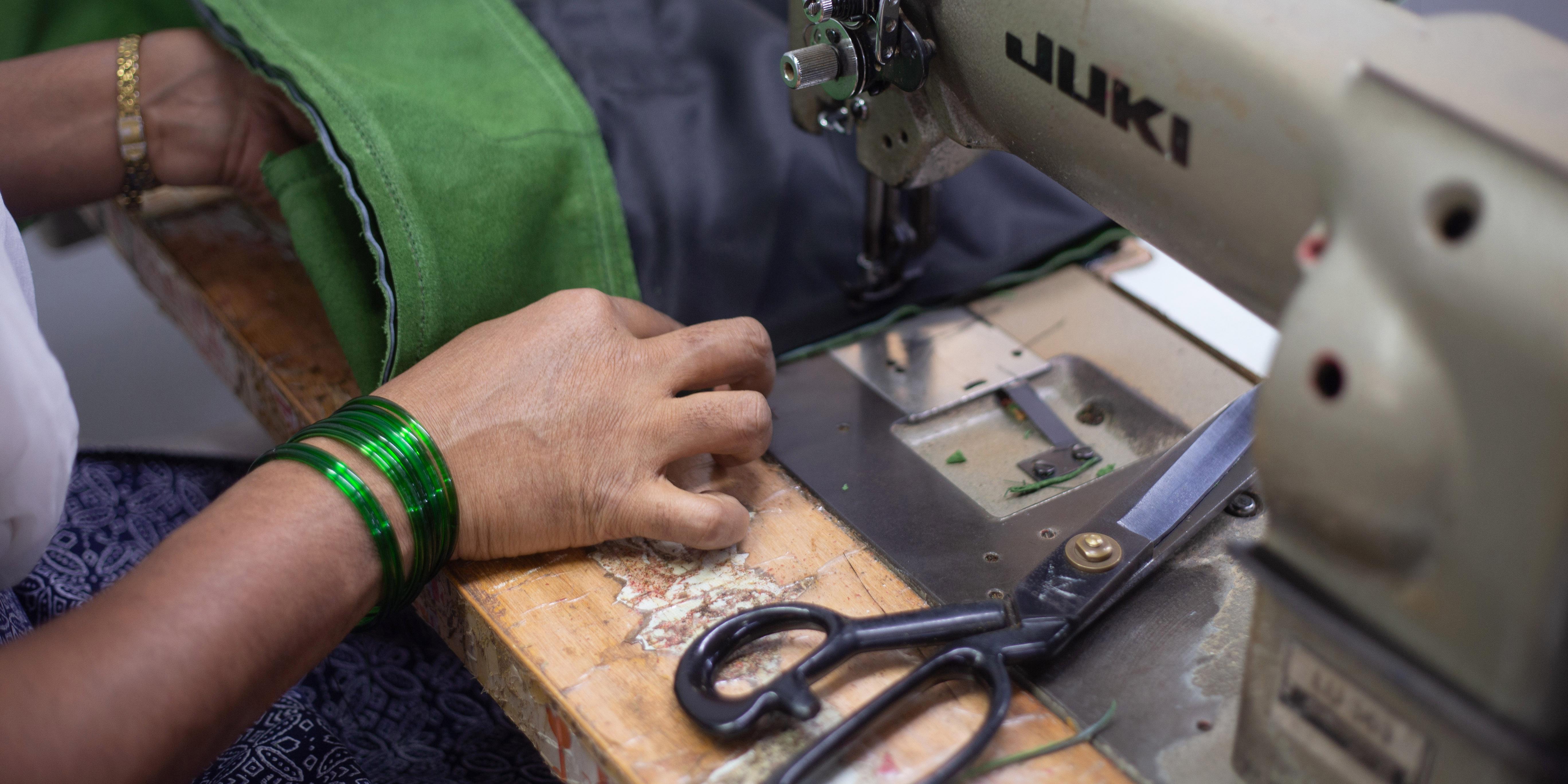 women stitching fabric