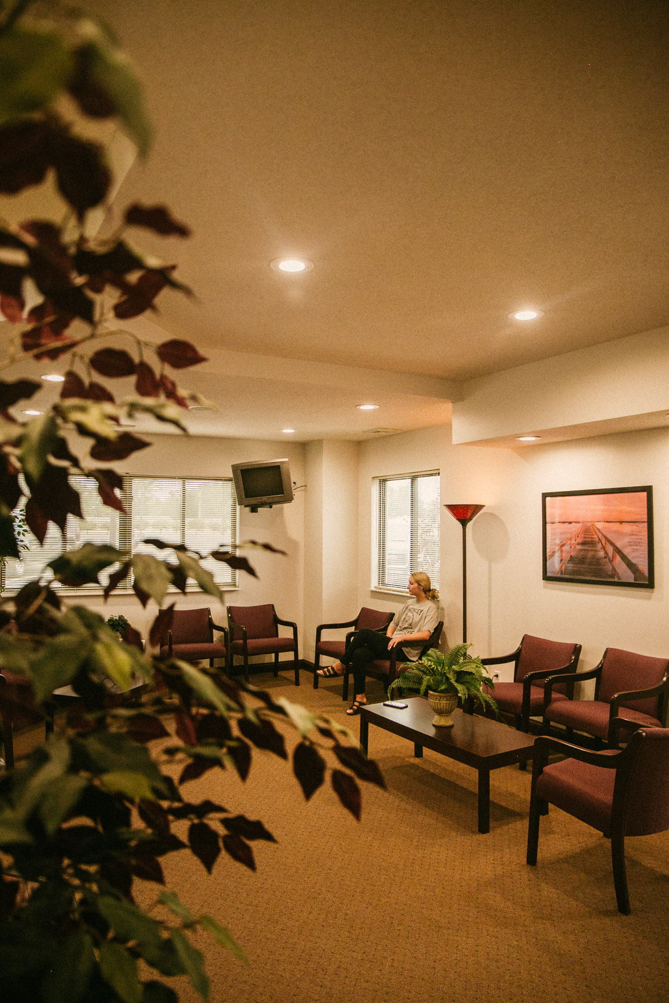 A lady sits in a welcoming waiting room