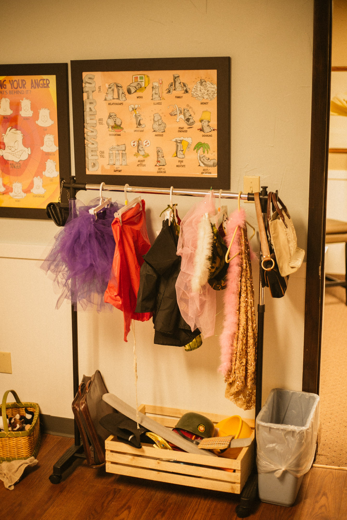 A rack of hanging clothes in the play therapy room