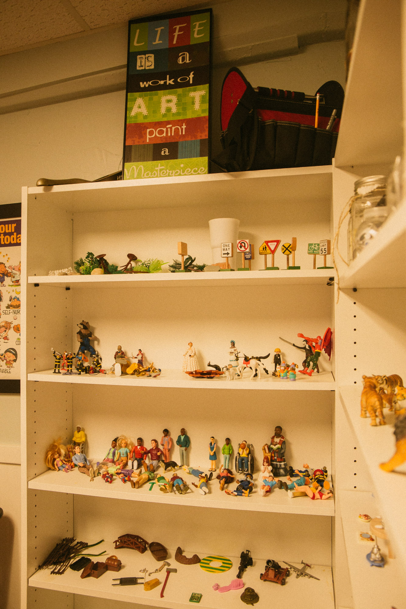 A shelf full of action figures used in play therapy