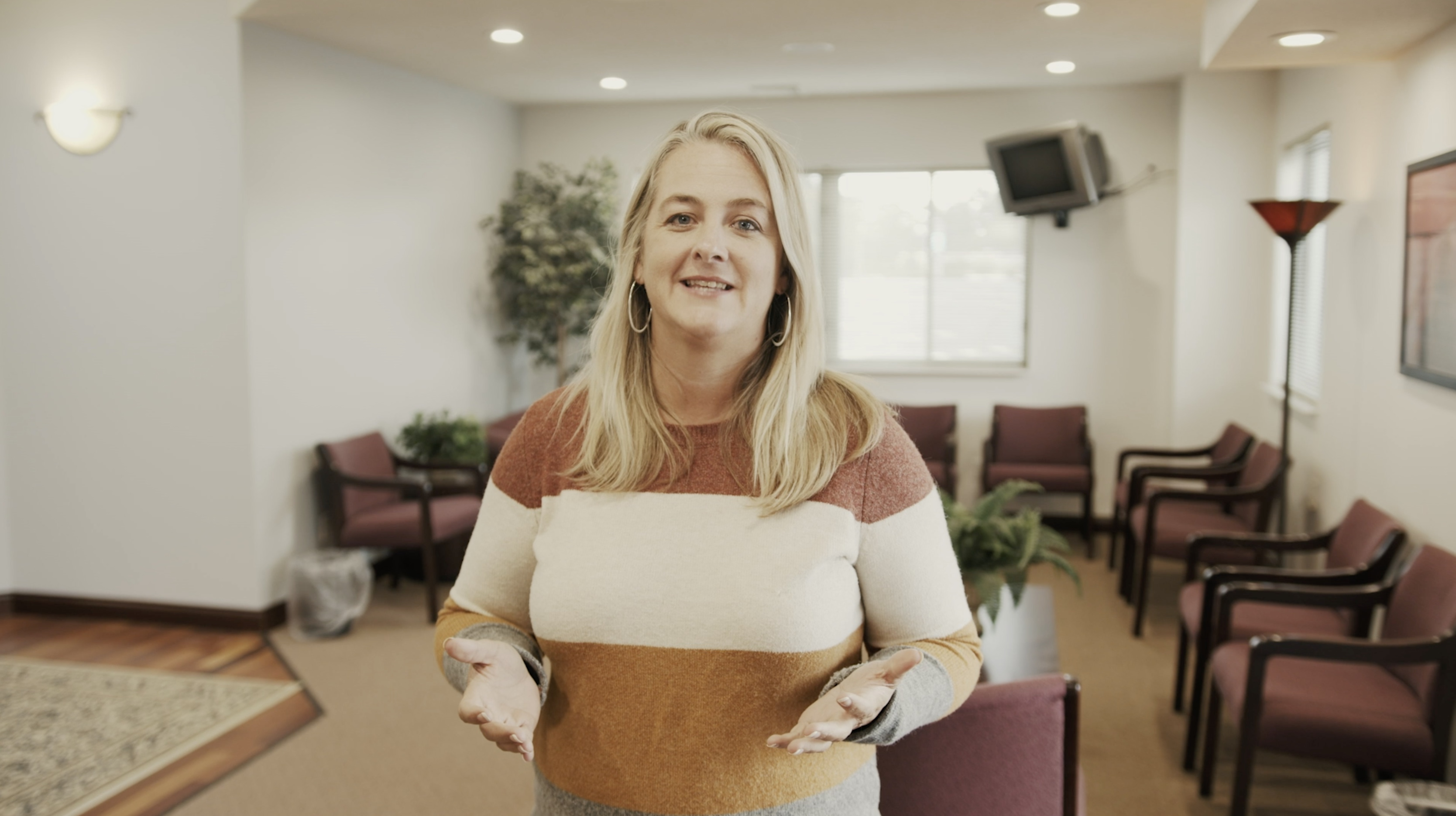 Mendy, the Counseling Center Director, smiles as she welcomes guests to The Counseling Center.