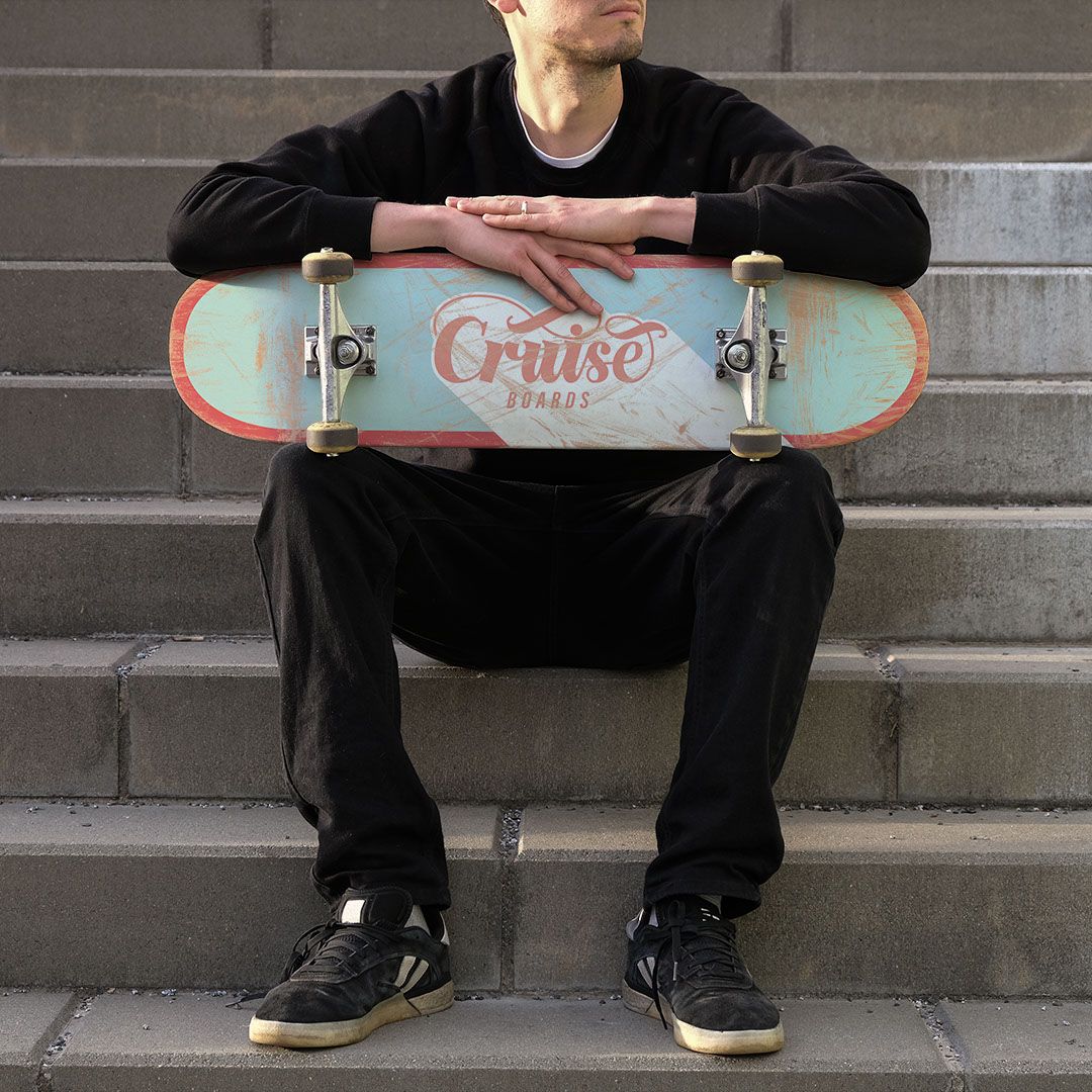 Cruise Boards graphic on roughed-up skateboard