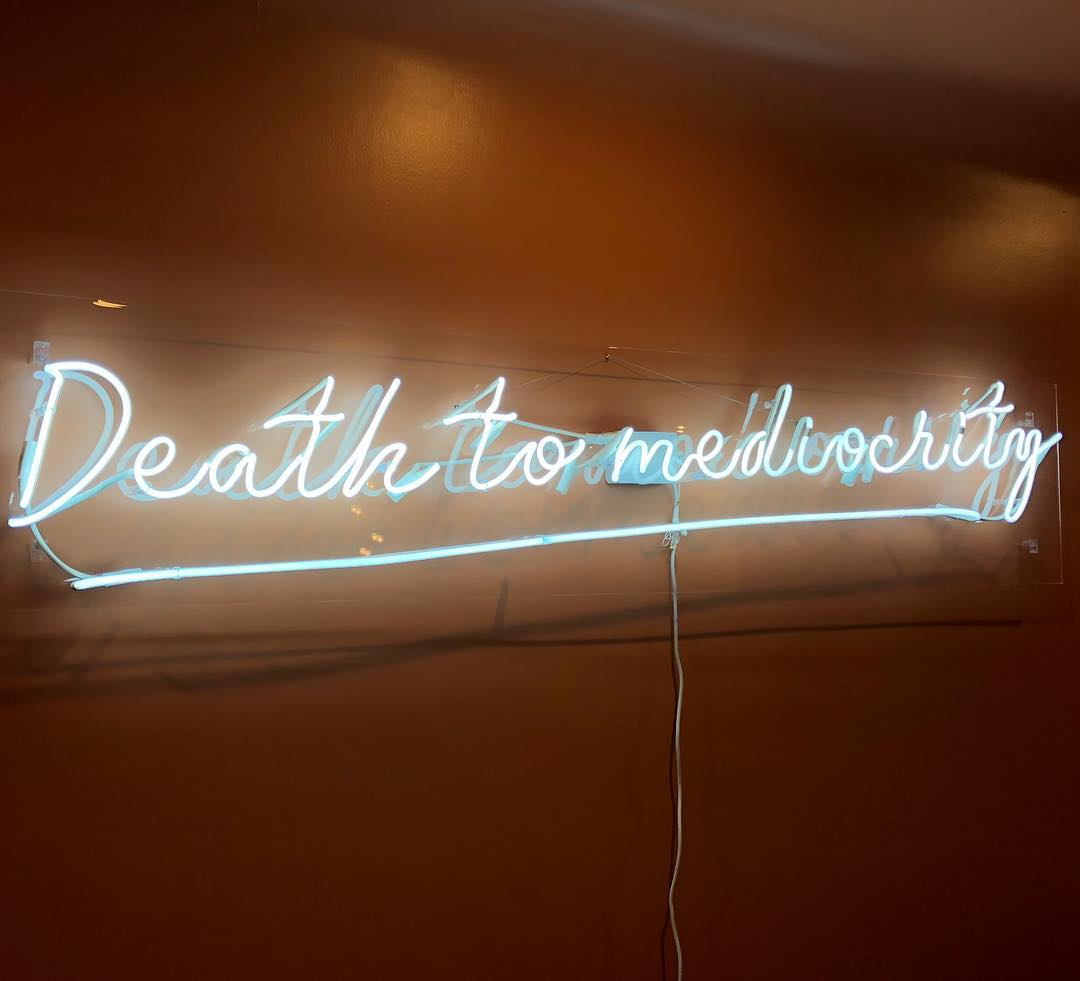 neon sign on clear acrylic backing