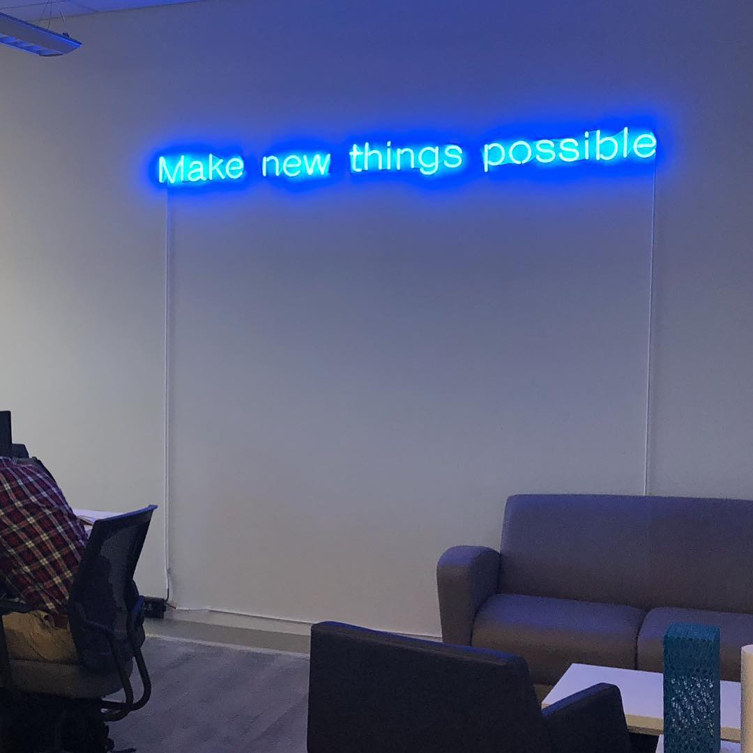 neon sign mounted directly on wall with electronic transformer