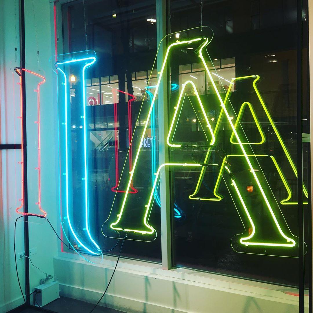 window neon sign on custom cut backing