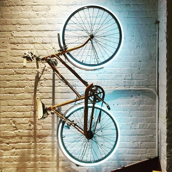 neon sign on bicycle