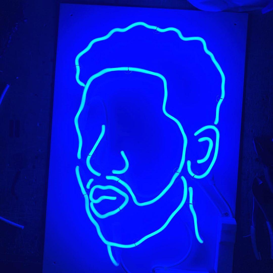 neon sign on white acrylic
