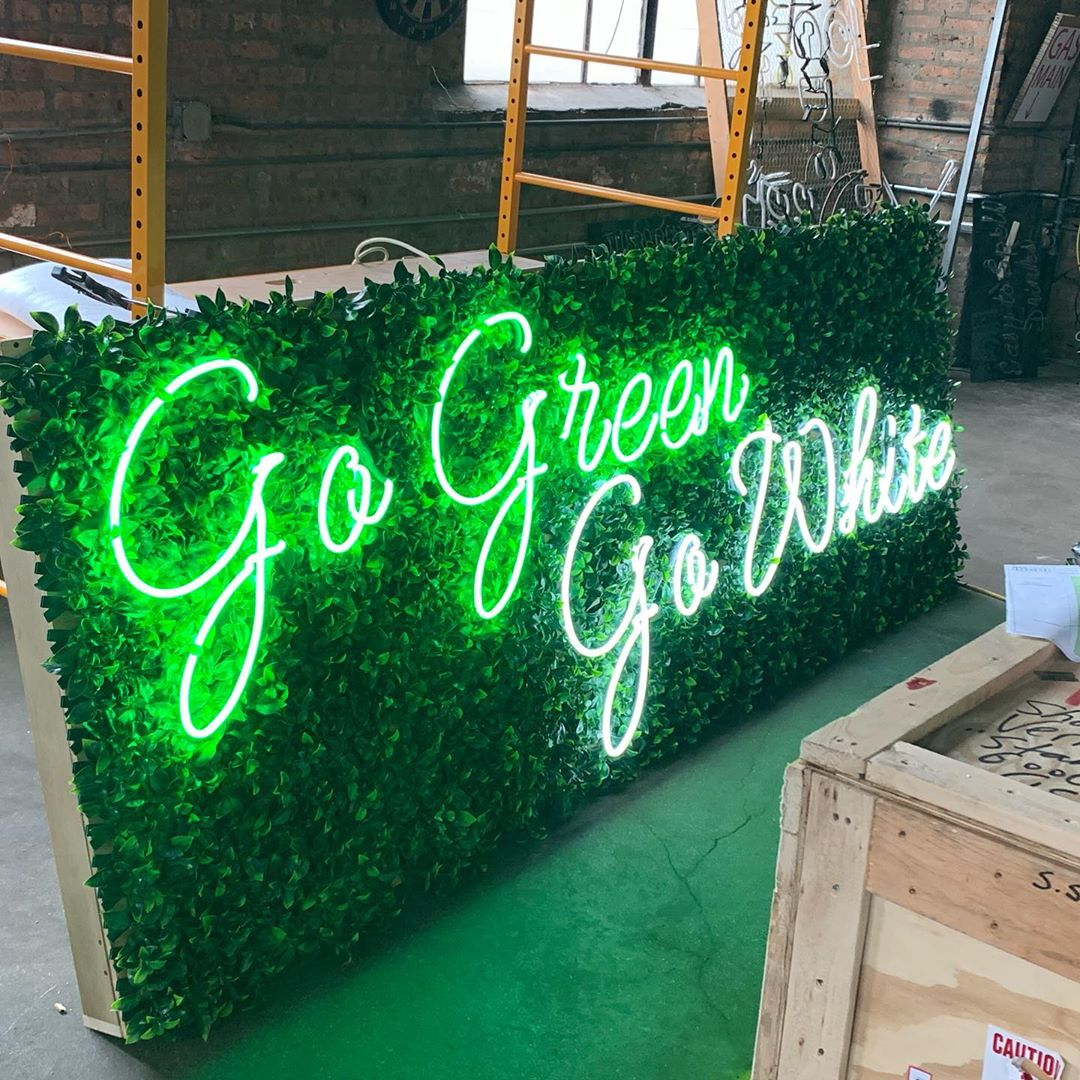 neon sign on faux grass tiles