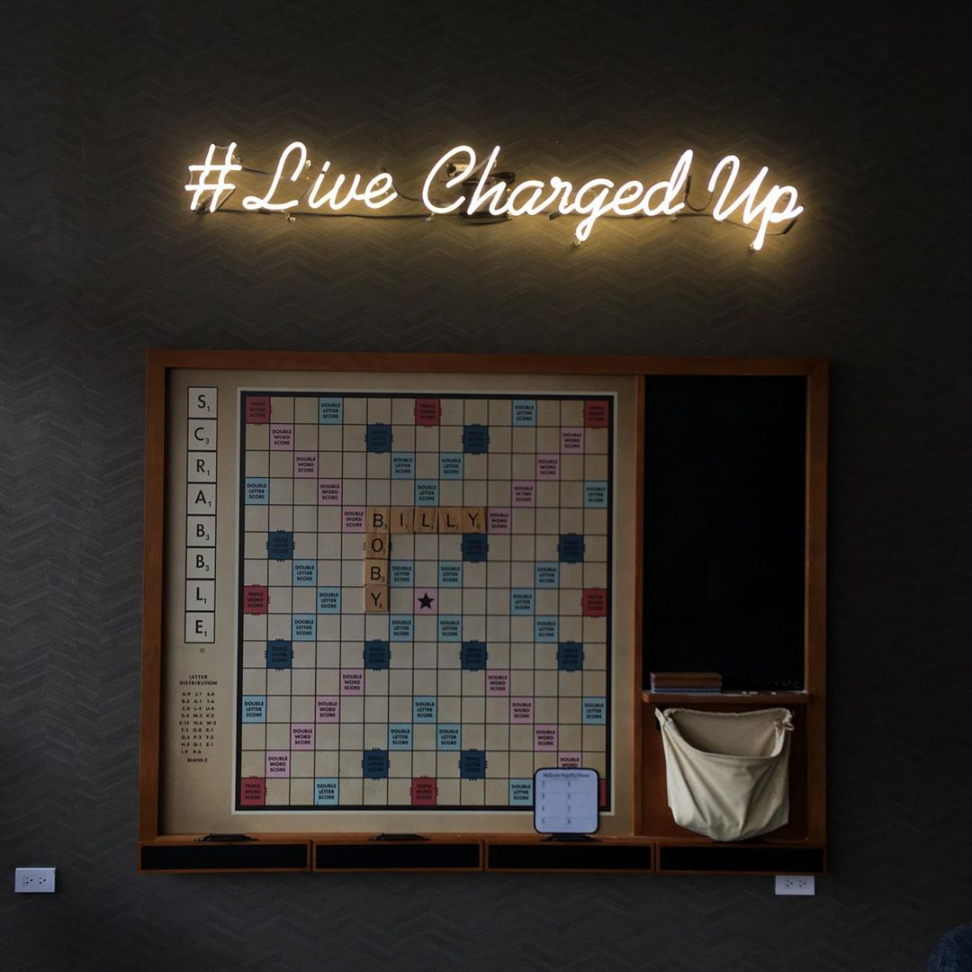 neon sign mounted directly on wall