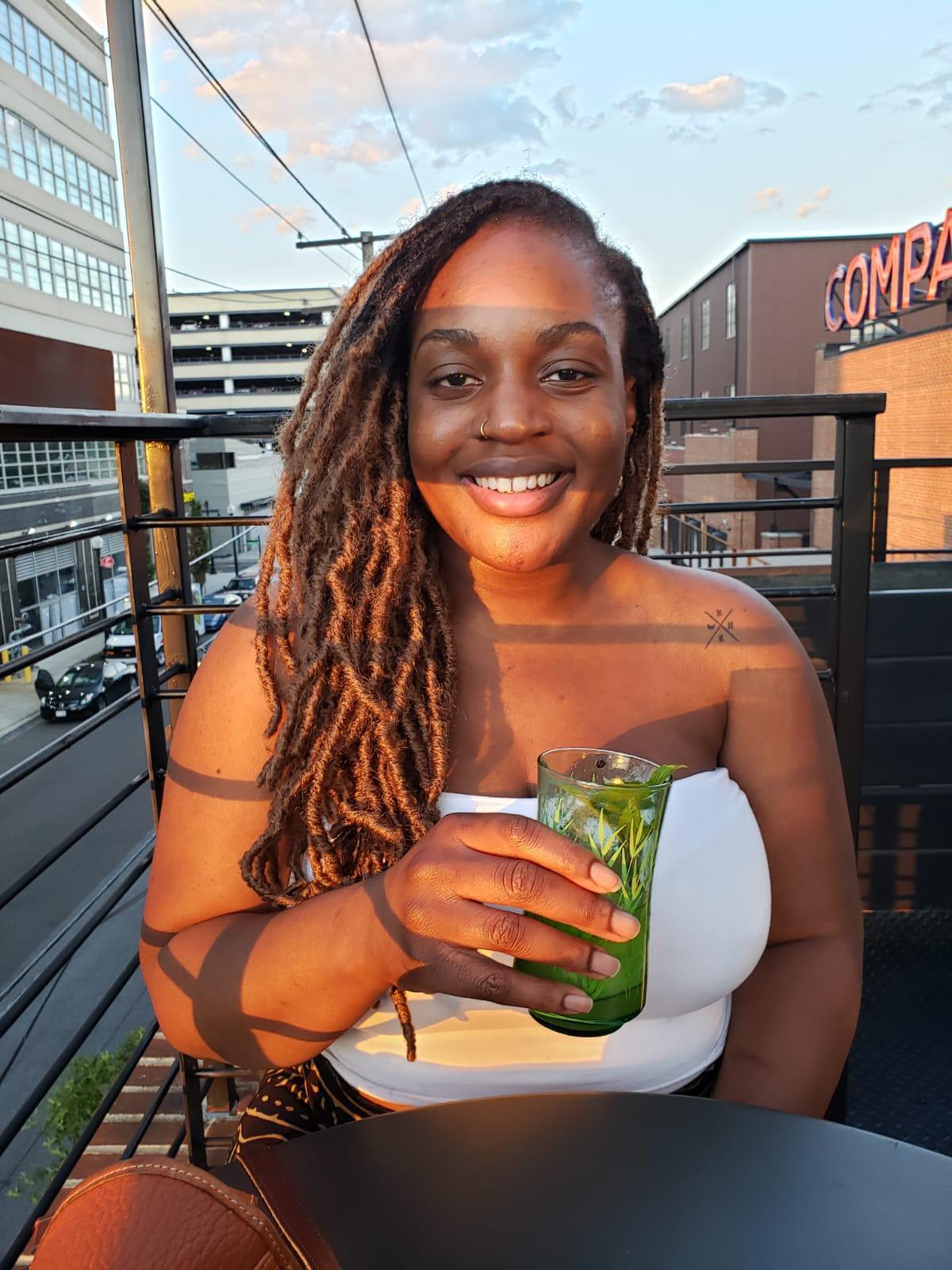 Photo of Anna enjoying a drink