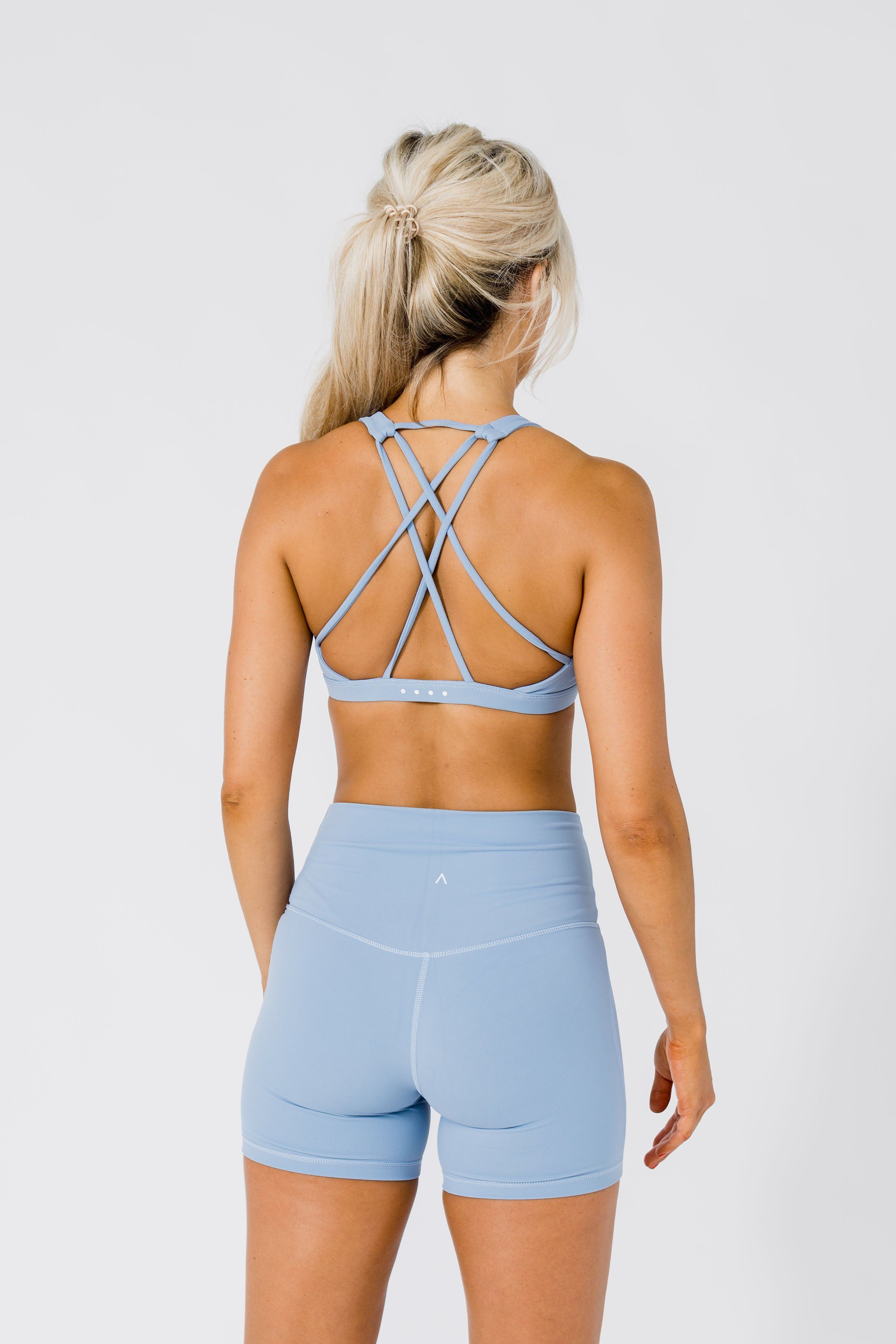 woman seen from theback with grey workout apparel