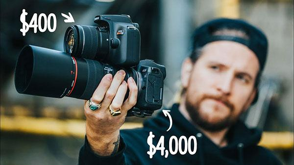 Youtube content creator Peter Mckinnon holding a camera for review