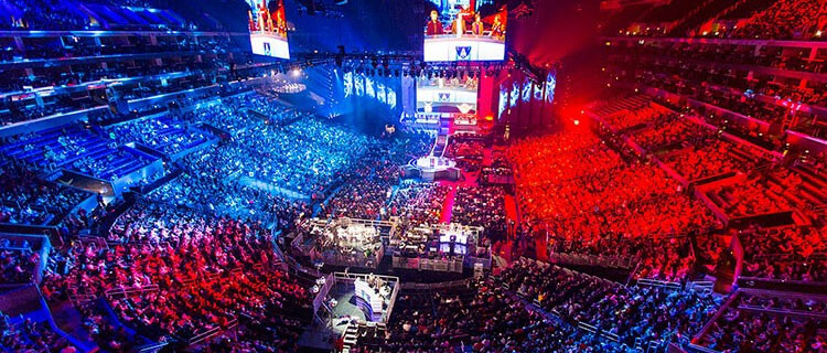 a fully packed stadium of fans watching esports