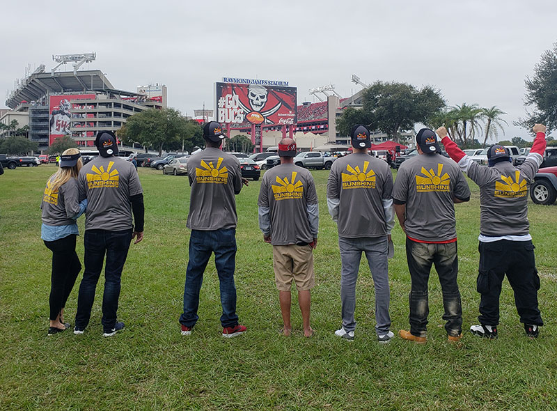 Sunshine Movers team at the Bucs game