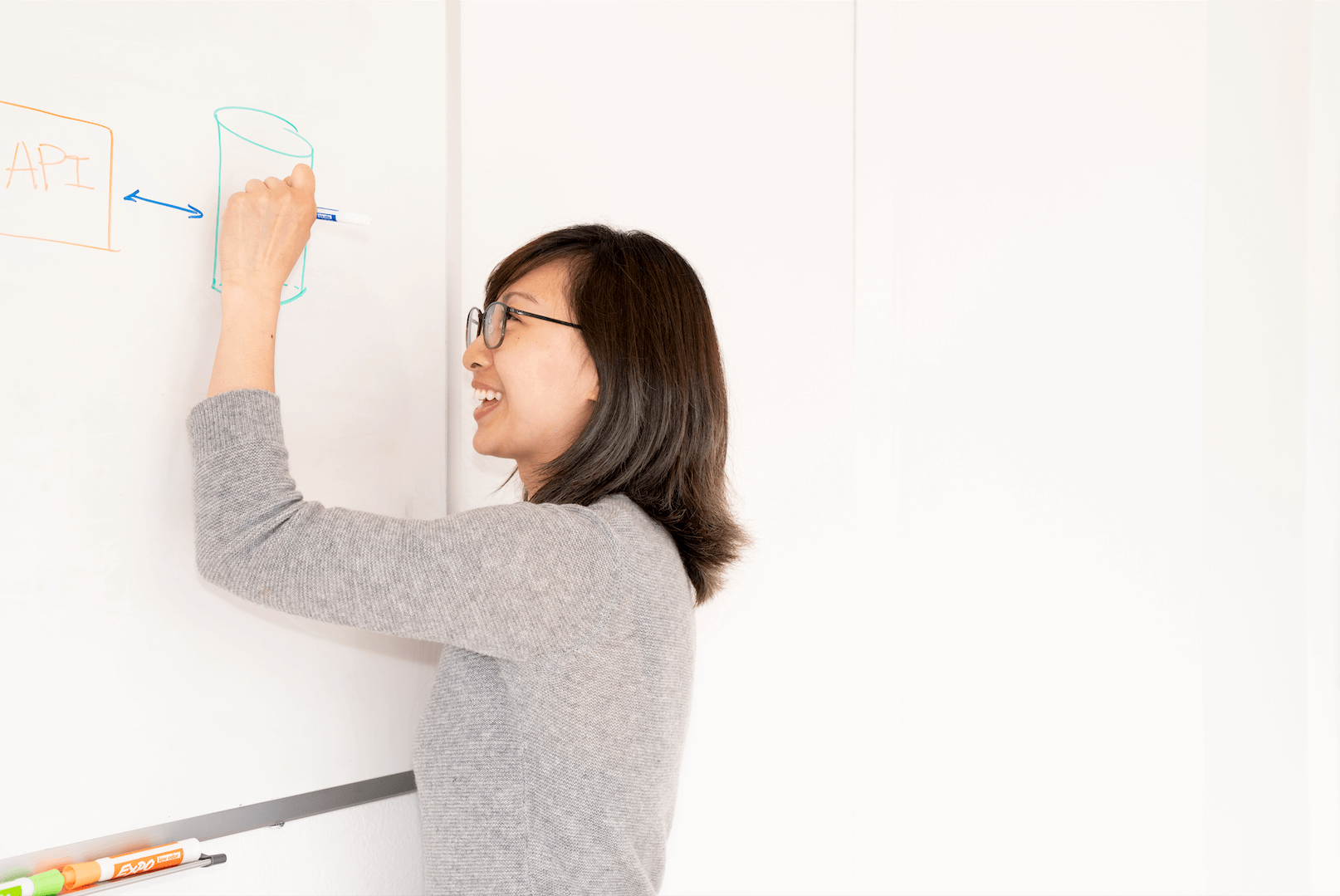 Pathpoint team member draws on whiteboard