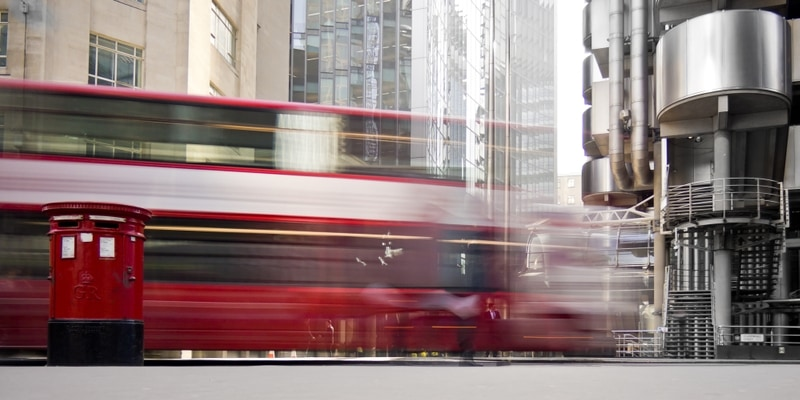 Lloyd's of London with a red bus out front