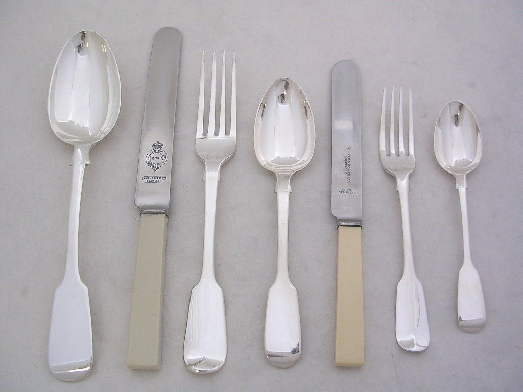 A selection of silverware, some with cream handles.