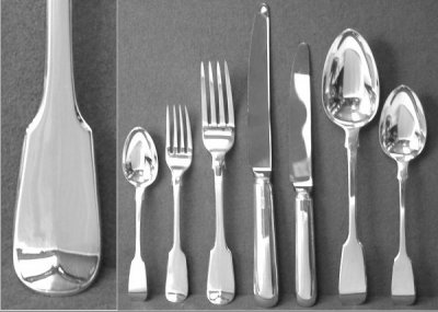 A selection of silverware with a close up of a handle
