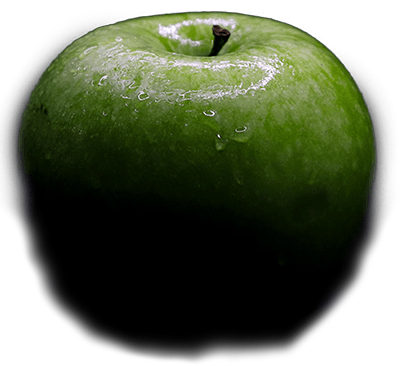 A green apple that falls into the scene.