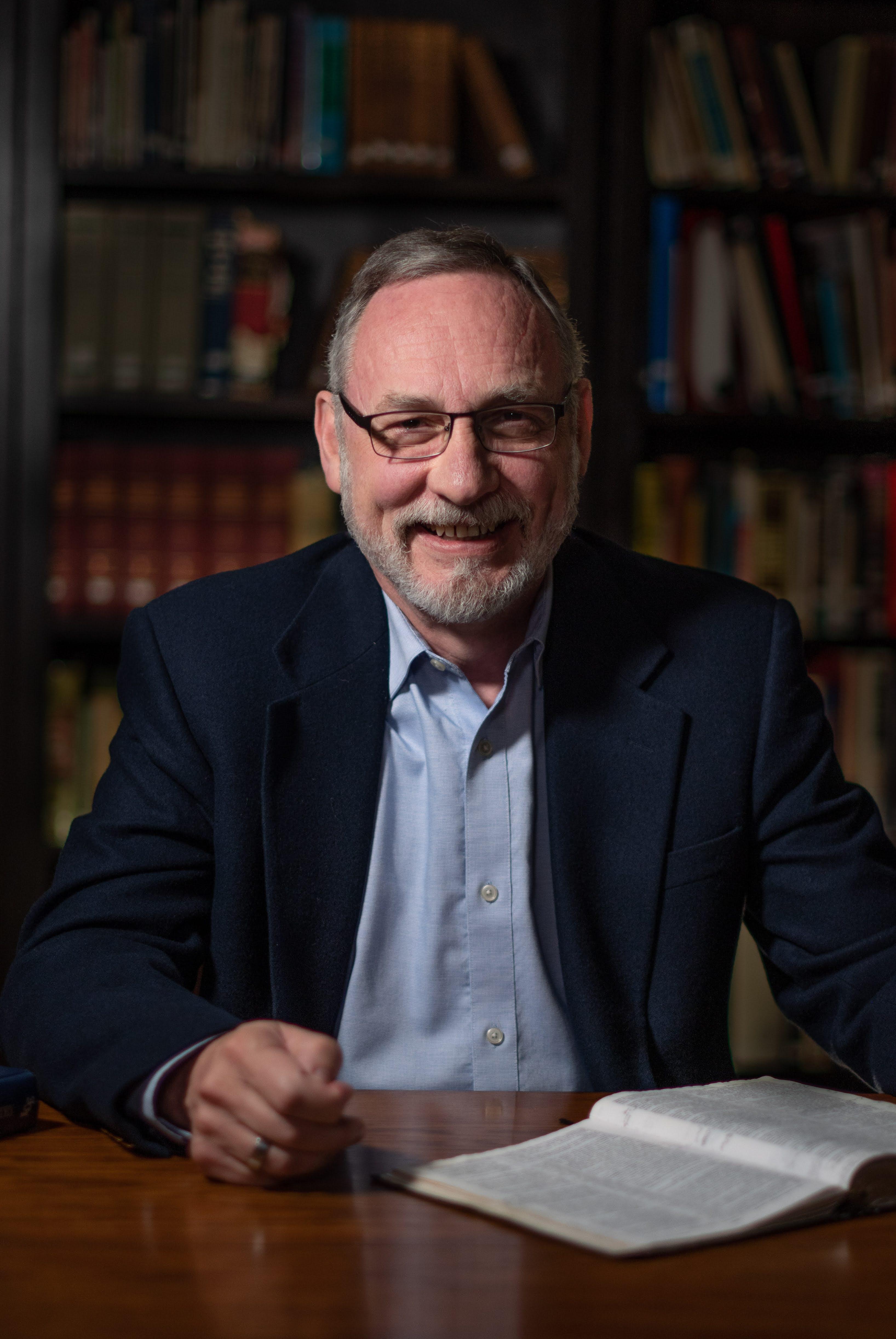 Dr. Kayser smiling theologically