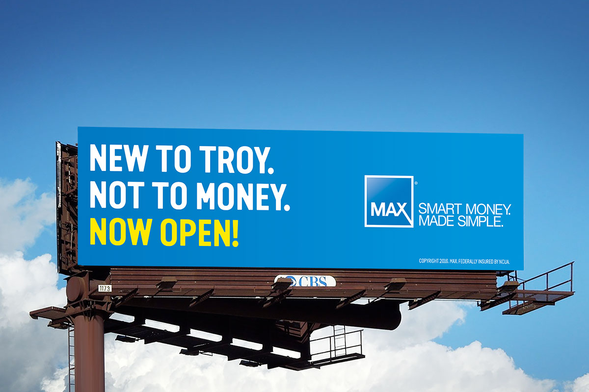 Max Credit Union billboard – New To Troy. Not To Money. Now Open!