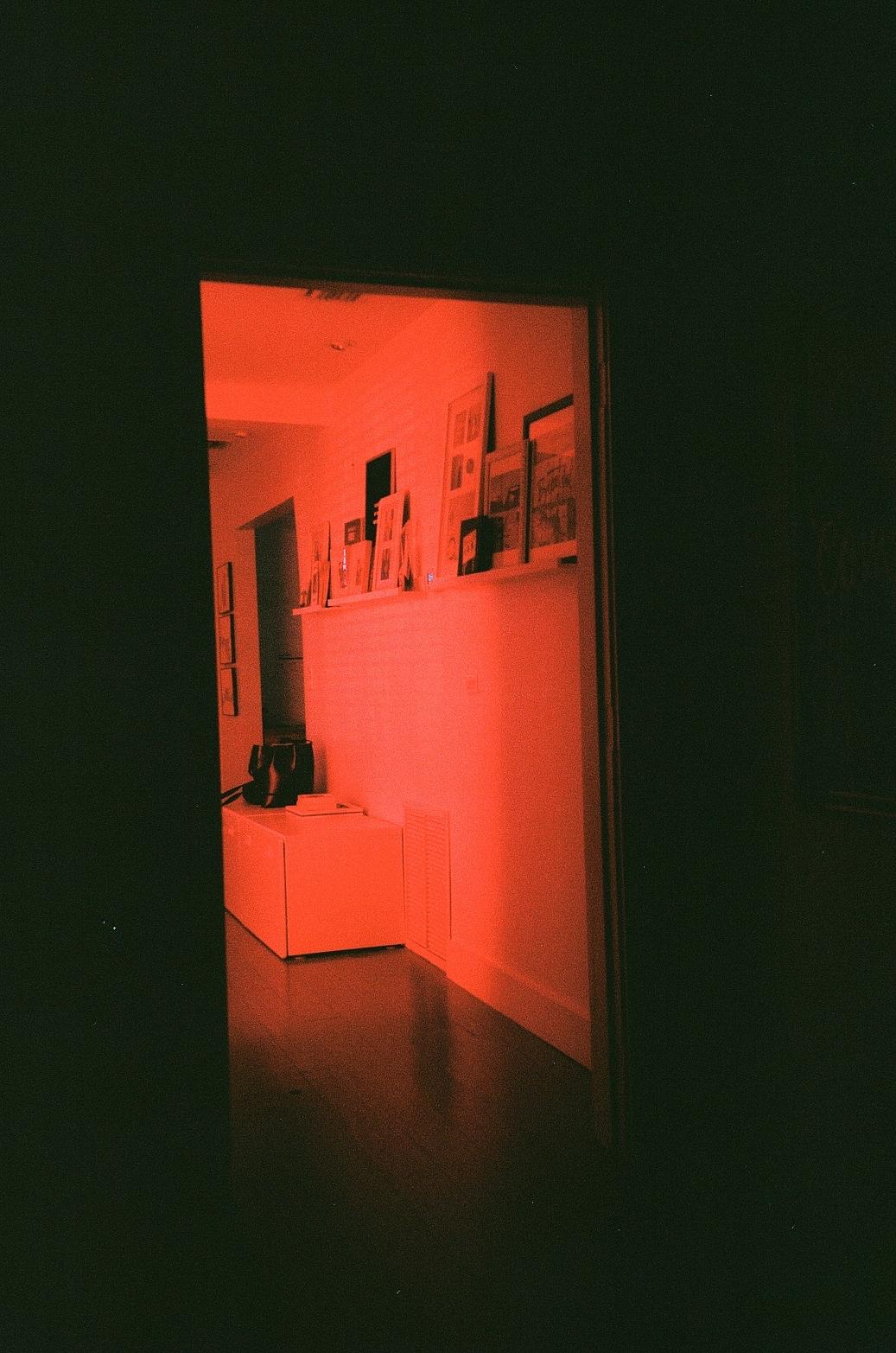 Film photo of Red light shining through doorway in Miami