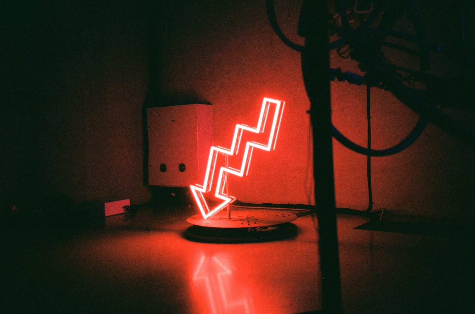 Red lightning bolt neon sign in PAMM