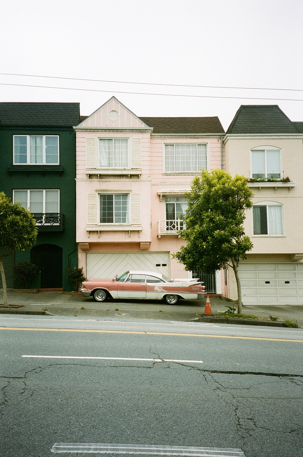 San Francisco apartments with classic pink car sitting in front