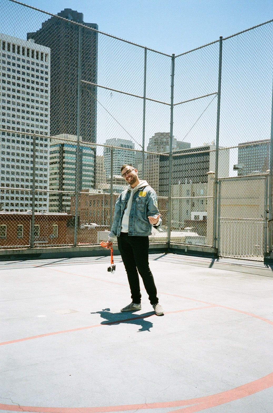 Pursuit of Happiness basketball rooftop photo of photographer in San Francisco