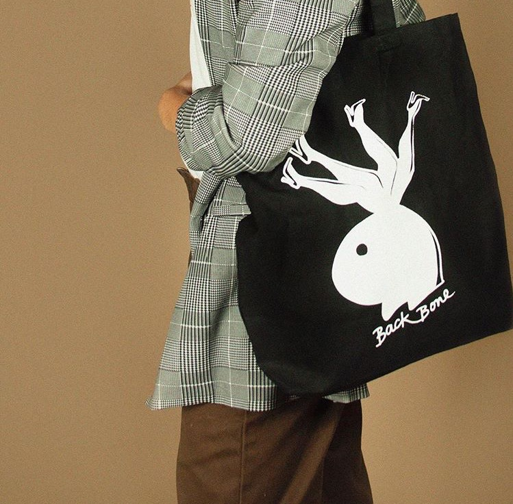 Cropped photo of model wearing Backbone bunny tote bag