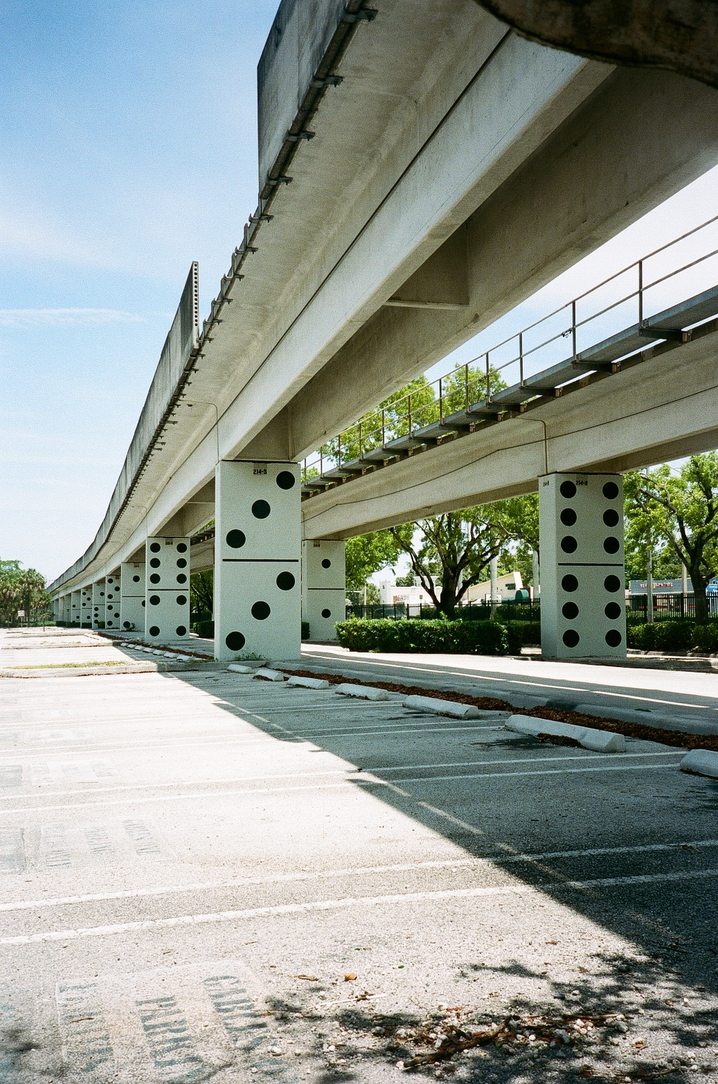Miami film photo of domino's artwork under metro rail