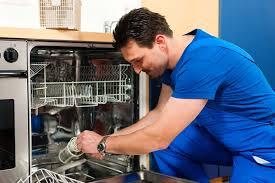 man repearing dishwasher