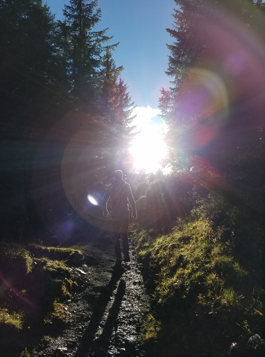 A dramatic photo of Cale on a hike in Switzerland
