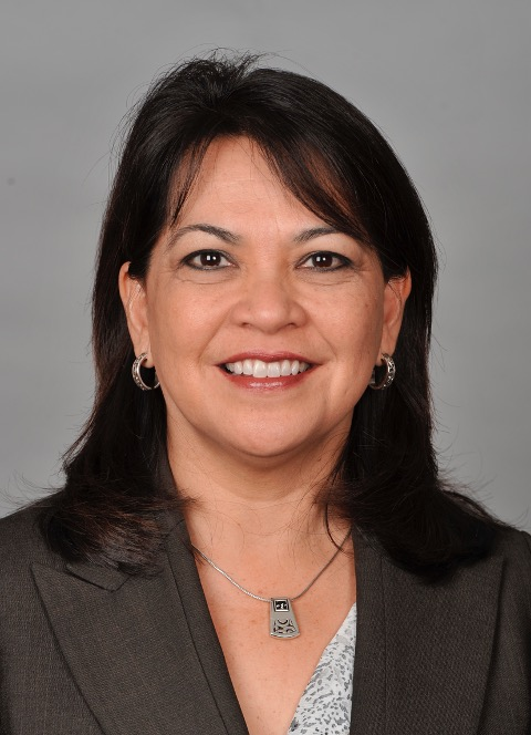 A professional headshot of Ruth Perez Ashley