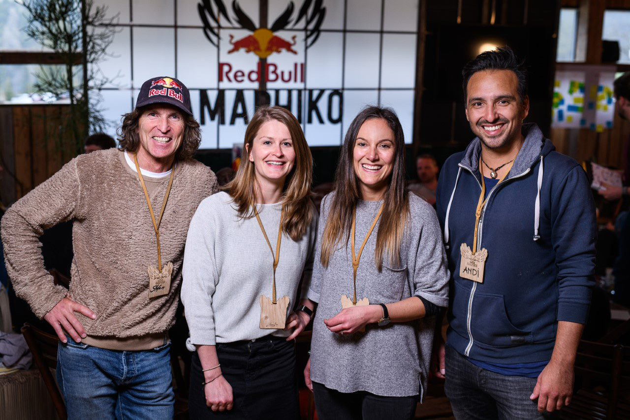 A group of 4 people including Daniela and Andreas standing with the Red Bull Amaphiko logo on the background