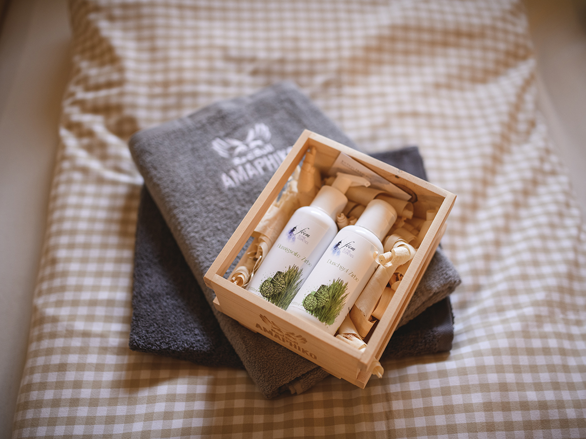 A wooden box with bottles of cream